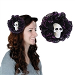 The Skull Hair Clip will add a little flair to your Halloween or Day of the Dead outfit. A white plastic skull is surrounded by layers of black lace tipped with purple glitter. Simply clip into your existing hair. No returns accepted.