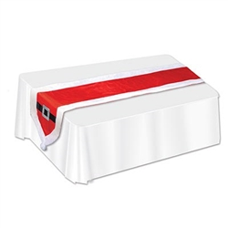 The Santa Suit Fabric Table Runner is red with white trim and at each end is a black belt with a silver glittery buckle and a white pom pom. It measures 13 inches wide and 5 feet 9 inches long. Made of fabric. Contains one per package. Surface wash only.