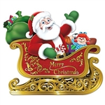 "Santa in Sleigh cutout features a waving Santa surrounded by large green toy filled sacks! Santa's red sleigh says ""Merry Christmas"" on the side and has golden printed runners. Made of card stock and measures 24.75 inches by 29 inches."