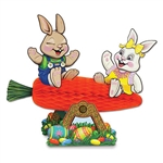 Get in the Easter spirit by decorating with this creative tissue centerpiece. Our Carrot Seesaw w/Bunnies tissue centerpiece features a boy and girl bunny sitting atop a carrot seesaw. It's a fun, creative centerpiece that is perfect for your Easter party