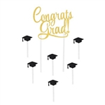The Congrats Grad! Cake Topper is made of cardstock and reads Congrats Grad! in gold glittered lettering. Printed on one side. Measures 5 inches wide and stands 8 1/2 inches tall. Includes 6 black caps measures 1 1/4 inches atop a 2 1/2 inch pick.