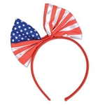 The Patriotic Bow Headband features a fabric bow printed with the stars and stripes attached to a red fabric covered headband. Sized to fit most adults and large children. One per package. Perfect for 4th of July or any patriotic event.