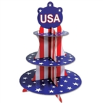 The Patriotic Cupcake Stand has red and white stripes and the tiers are blue with white stars. It measures 16 inches tall and has three tiers. Made of cardstock. Contains one per package. Simple assembly required.