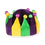 The Plush Jester Crown is purple, golden yellow, and green with contrasting fabric balls on each tip. Made of plush material and measures approx 6 inches high and has an inside circumference of approx 22 inches. One size fits most. One per pack. No return