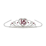 The Sweet 16 Royal Rhinestone Tiara features a silver metal tiara adorned with realistic looking gemstones in an intricate design. A rhinestone heart featuring the number 16 is centered on the front. One per package.