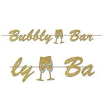 The Bubbly Bar Streamer is made of cardstock with a holographic film finish. Bubbly bar is in gold script with a cutout of two champagne glasses clinking together. Measures 7 1/2 inches tall and 5 feet long. One per pack. Simple assembly required.