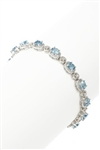 OVAL AQUAMARINE AND DIAMOND TENNIS BRACELET IN 14K WHITE GOLD