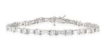 BAGUETTE AND ROUND DIAMOND TENNIS BRACELET IN 18K WHITE GOLD