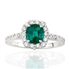 CUSHION EMERALD AND ROUND DIAMOND RING IN 18K WHITE GOLD
