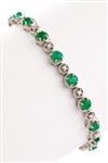 ROUND EMERALD AND DIAMOND BRACELET IN 18K WHITE GOLD