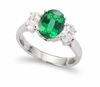 OVAL EMERALD AND ROUND DIAMOND RING IN 18K WHITE GOLD