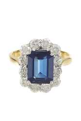 EMERALD CUT SAPPHIRE AND ROUND DIAMOND RING IN 18K TWO TONE