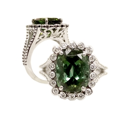 CUSHION EMERALD AND ROUND DIAMOND RING