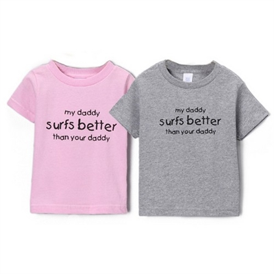 "This soft 100% combed cotton kids/toddler short sleeve shirt is silkscreened with a cool graphic ""My daddy surfs better than your daddy."" Available Pink or Gray. Sizes are 6 mo, 12 mo, 18 mo, 2T, 4T, 5/6T..."
