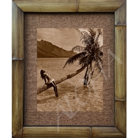 """Girl on Palm"" Vintage Tahitian Art Print. Beautiful image of a Tahirtian girl sitting on a palm tree that stretches out over the ocean. Matted in a Natural Grass Mat and framed in a handmade Natural Bamboo Frame. Bamboo Frame is hand sanded and..."