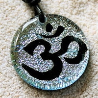 Dichroic Glass pendant OM Aum Yoga Reiki Hindu CharmOm Pendant is spiritual jewelry which represents peace and tranquility.It represents the three words : Creation, Preservation and Destruction. the pendant is hand crafted in silver Color dichroic...