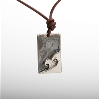 This Wave Art Pendant was hand carved out of wax and casted in Sterling Silver or silver plated pewter and then antiqued to make the wave come alive. Its carved in a dog tag design, which is the hottest classic design. It comes on a leather cord. The...