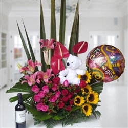Exotic arrangement with teddy bear and balloon and bottle of wine Casillero del Diablo