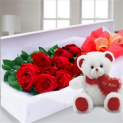 Roses in a box and teddy bear.
