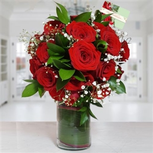 Two dozen red roses bouquet in glass vase