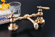 Strom Plumbing - P0565-8S Columbia Supercoat Brass 8 inch Bridge Faucet with Metal Lever Handles and Straight Spout