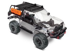 82010-4 - TRX-4 Sport Unassembled Kit: 4WD Electric Truck with clear body, expedition rack, and accessories. Radio system (transmitter, receiver, servo) and power system (ESC, motor) not included.