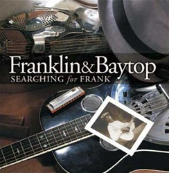 Michael Baytop and Rick Franklin play acoustic blues guitar, harmonica - and bones.