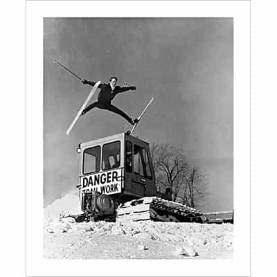 Vintage photo of Ski Patrol Jumping over a Snowcat (Black & White or Sepia, 2 Sizes: 8 x 10 and 11 x 14 inches)