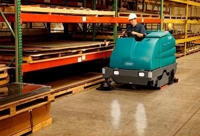 Battery Powered Rider Tennant Floor Scrubber Rental - Warehouse floor scrubber rental