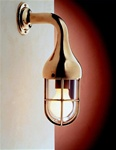Brass wall light wih protective gille