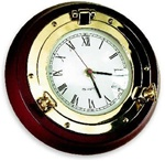 SOLID BRASS PORTHOLE CLOCK ON MAHOGANY