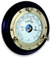 SOLID BRASS PORTHOLE BAROMETER ON MAHOGANY