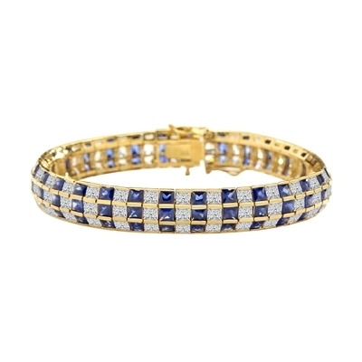 "7"" long Lovely best selling bracelet with 23.25 Cts. T.W. of square Sapphire Essence and white princess cut stones set in 14K Solid Yellow Gold."
