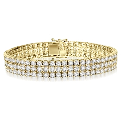 A majestic looking 7 inch Bracelet with 3 rows of brilliant masterpieces. Appx. 16 Cts. T.W. set in 14K Solid Yellow Gold.