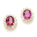 Designer Oval studs with 2.50 Cts. Ruby in center, surrounded by 14 Round Brilliant Diamond Essence Stones Appx. 6.0 Cts. T.W. set in 14K Solid Yellow Gold.