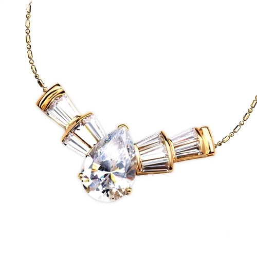 Astonish everyone with this magnificent display of 7.25 Cts. Pear cut Diamond Essence in Center, with 5 lovely baguettes tapering on each side. Marvelous! 10.0 Cts.T.W. attached with Chain in 14k Solid Yellow Gold.