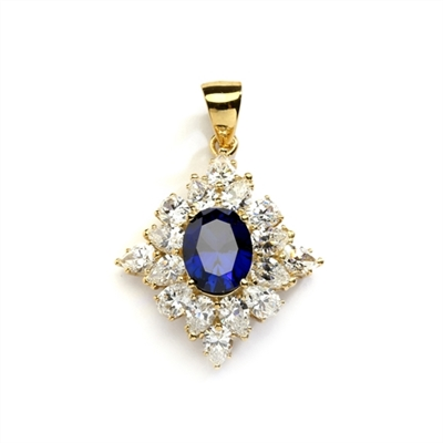 Designer pendant with 3.5 Ct. oval Sapphire Essence set in four prongs, and surrounded by pear cut diamond essence stones in floral pattern. 8.5 Cts. T.W. et in 14K Solid Yellow Gold.