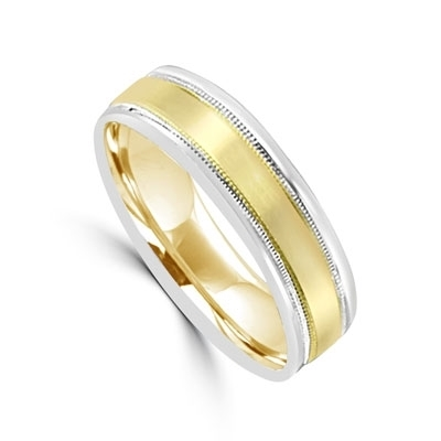 Smart 14K two-tone wide Gold Band with Yellow Gold in the center and White Gold on each side. Beautiful intricate filigree on the outside edges for even more beautiful music.
