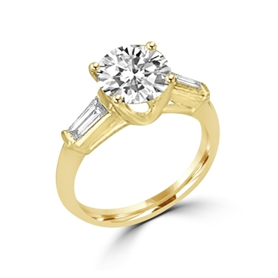14K Solid Gold Diamond Essence engagement ring. 1.0 ct.round brilliant stones and delicate baguette on each side. 1.25 cts.t.w. Perfect for the occassion.