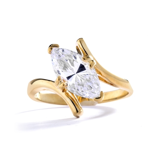 Solitaire Ring with artistically set  Diamond Essence Marquise in prong setting. 1.5 Cts. T.W. set in 14K Solid Yellow Gold.