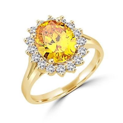 Light your fire with this Cocktail Ring,3 cts. Oval cut Canary Diamond Essence Center and accents encircling the fireworks! 3.5 Cts. T.W. set in 14K Solid Yellow Gold.