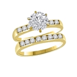 Beautiful wedding set. 1.0 carat Diamond Essence set in six prongs setting, and small round brilliant melee set in channel setting, on both the bands.2.25 cts.t.w. in 14K Solid Gold.