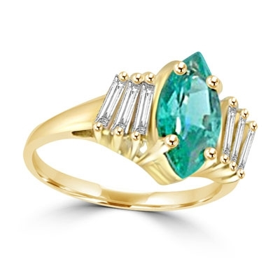Erin - 1.5 Cts. Marquise Cut Emerald Essence is shining bright in center, accompanied by 3 Baguettes on each side. In 14k Solid Yellow Gold.