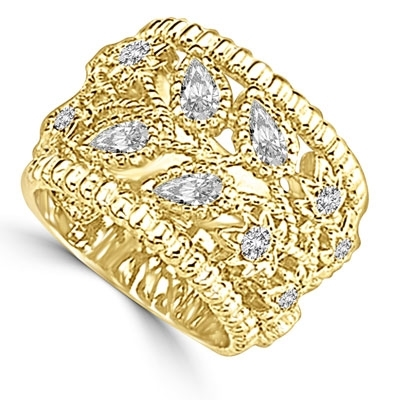 Ring – pear cut and round cut stone set in cut work fashion