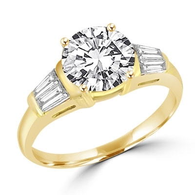 Majestic ring with 2.0 cts. round double cut center and baguettes tapered around both sides. 3.0 cts.t.w. in 14K Solid Gold.