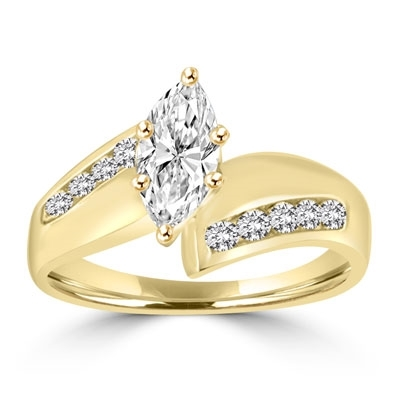Ring with 1 carat marquise cut stone in middle and round stones each side