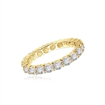 eternity band with round stone in yellow gold