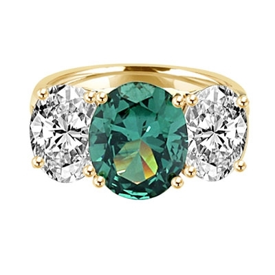 Three stone Jaw dropping oval Emerald stone ring