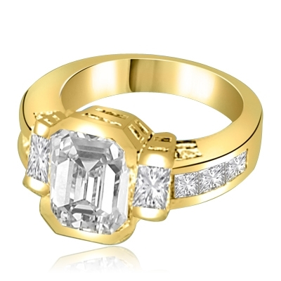 Not for the shy - this exquisite Ring with a 4 Ct. Bezel Set Radiant Emerald Cut Diamond Essence Masterpieces in the center and Princess Cut accents on both sides. 6 Cts. T.W, in 14K Solid Gold.