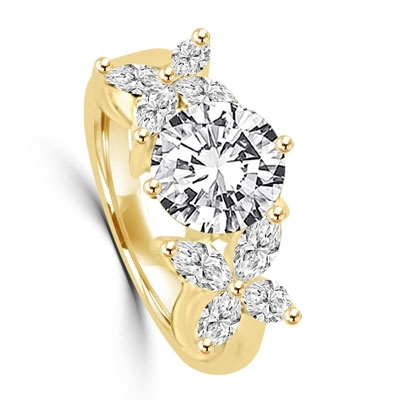 "Unusual Ring with a 2.0 Ct. Round Brilliant cut Diamond Essence center stone supported by a vibrant ""X"" on each side with 8 Marquise Cut Masterpieces. 3.2 Cts. T.W, in 14K Solid Gold."